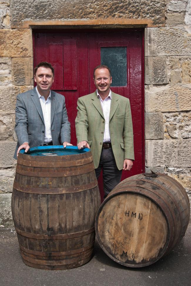 David Moore, Clansman and Director of Fusion Whisky and Alex Bruce, Managing Director, Adelphi Distillery Ltd. 29 July 2016. Charlestown. Credit: Photo by Tina Norris. Copyright photograph by Tina Norris. Not to be archived and reproduced
