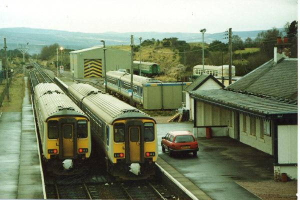 Two train pass at Muir of Ord. Photograph by Richard Ardern, courtesy of the Friends of the Far North Line