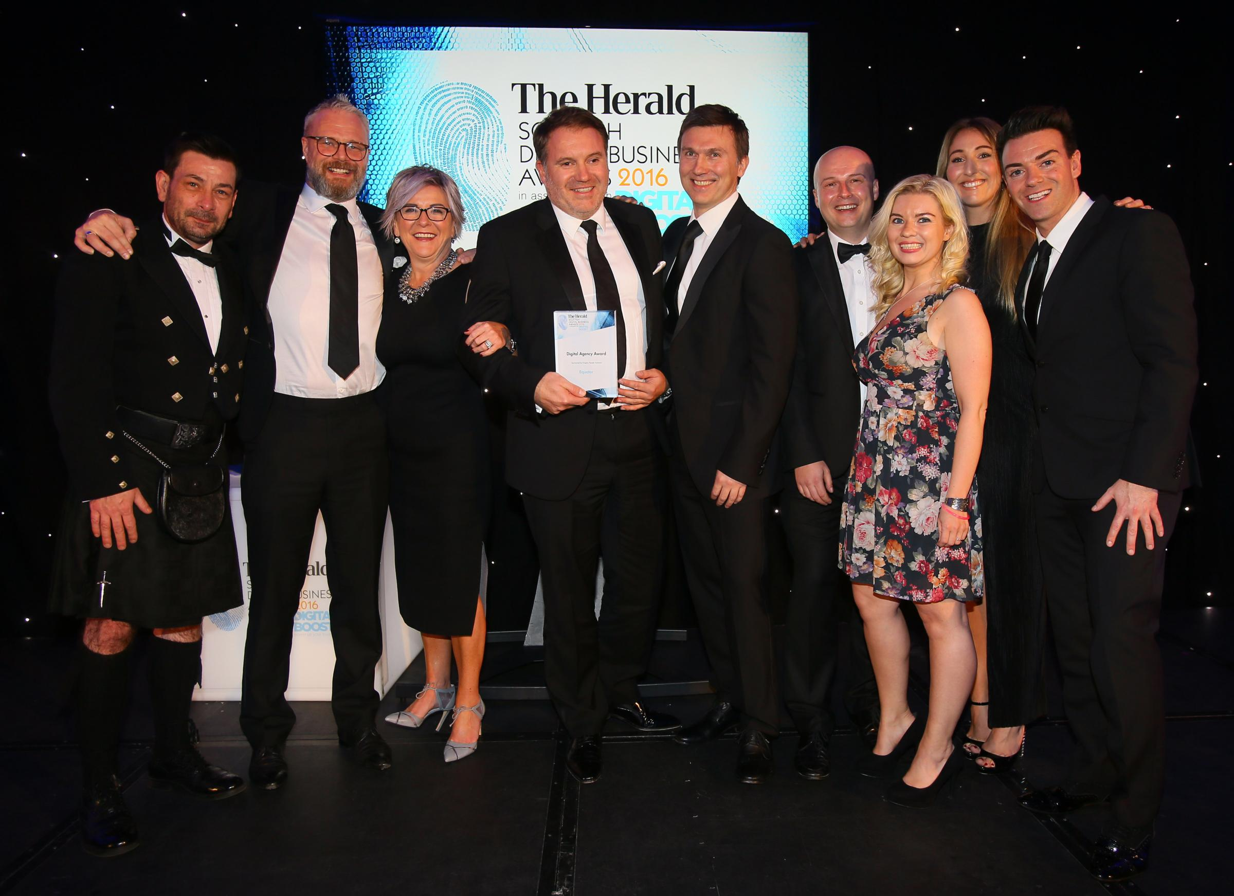 Winner of the Digital Agency Award is Equator. MD John McLeish pictured holding the award. Presenting the award was David Mains, far left of Enigma People Solutions and Host Des Clarke at right. Photograph by Colin Mearns