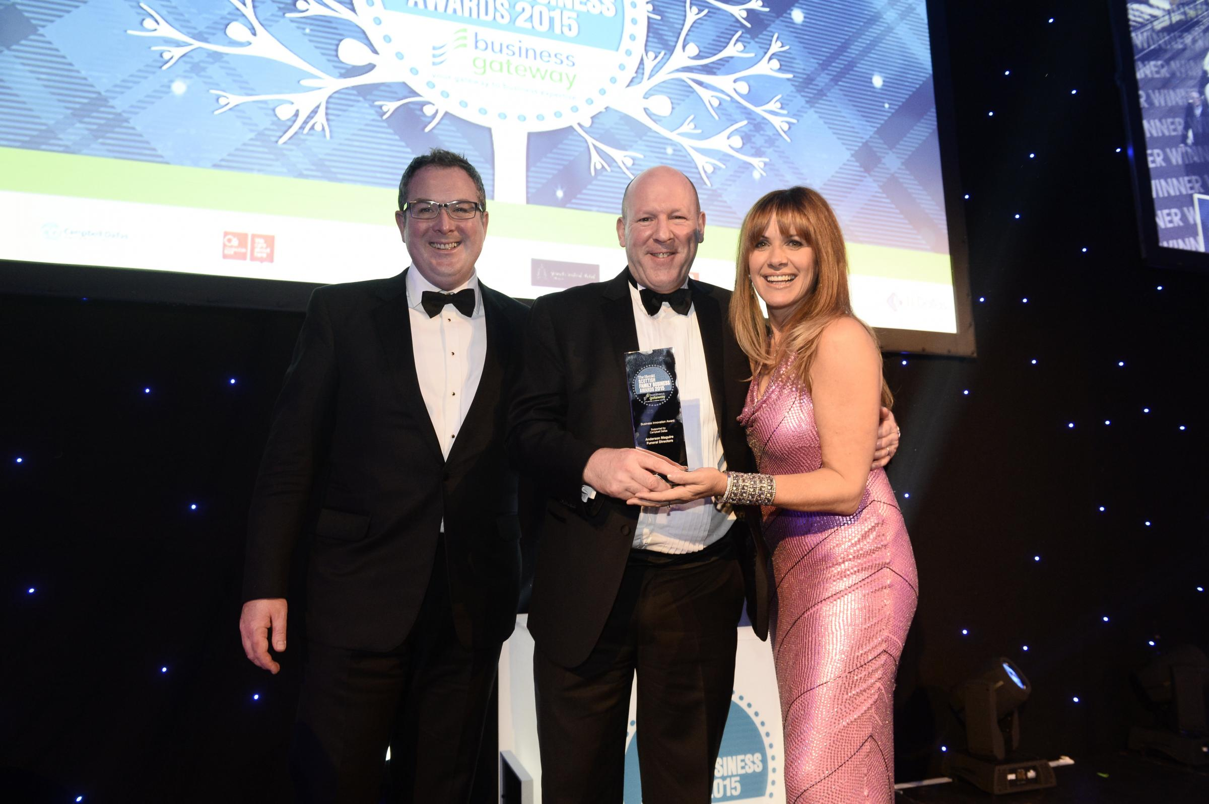 Fraser Campbell, left, with Anderson Maguire's Paul Webb and Carol Smillie at the 2015 awards.