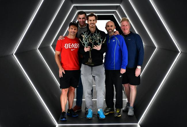 Andy Murray and his coaching team - Steven Kotze, Josh Murray, Jamie Delgado and Mark Bender pose with the 'Tree of Fanti' trophy following the Scot's victory in the Mens Singles Final against John Isner of the United States in Paris. Picture: