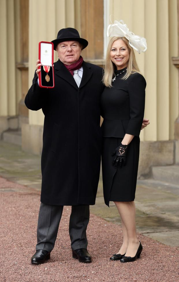 HeraldScotland: Van Morrison with his daughter Shana after receiving his knighthood in February 2016. Photograph: PA