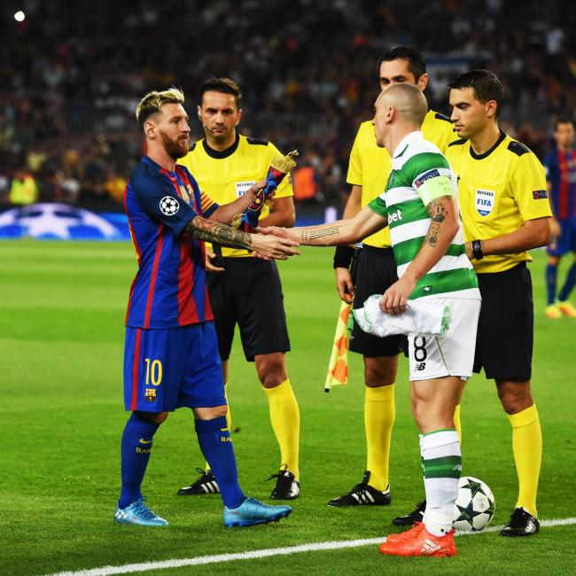 OLD HANDS: Captains Lionel Messi and Scott Brown before Celtic's 7-0 defeat against Barcelona at the Nou Camp.