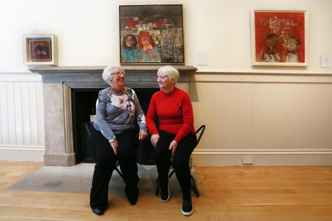 Mary McDonald and Pat McLean, who knew and posed for Joan Eardley, take a close look her work at the opening of Joan Eardley: A Sense of Place. They sit by a painting of them as children by Joan Eardley. Picture by Stewart Attwood.