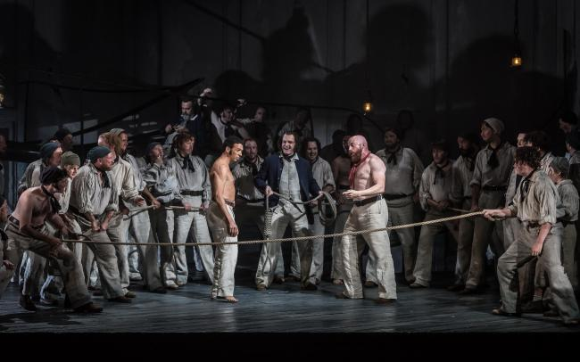 BILLY BUDD by Britten; Opera North; Gand Theatre; Leeds, UK; 15 October 2016;  RODERICK WILLIAMS  as Billy Budd;  EDDIE WADE as Donald (centre);           DANIEL NORMAN as Red Whiskers;                    GARRY WALKER - Conductor;                        O