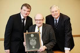 Sporting life: Raymond Jacobs (centre) was presented with a Lifetime Achievement award by the PGA in 2010 (Picture: Andy Forman/PGA)
