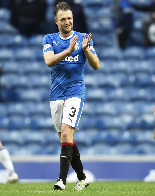 Clint Hill applauds the Rangers fans at full-time at Ibrox on Saturday.