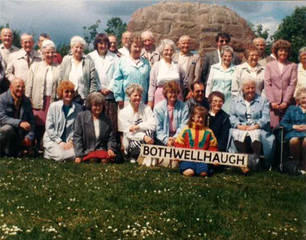 HeraldScotland: Herald writer Susan Swarbrick holds the sign at a Bothwellhaugh reunion in the 1980s.