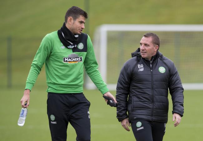 Nir Bitton and manager Brendan Rodgers during training    Photograph: SNS