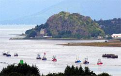 HeraldScotland: Fuel protests are nothing new. This flotilla of fishing boats, seen here passing Dumbarton Rock, made a point about the price of marine diesel in 2000 by sailing up the Clyde to moor at the SECC