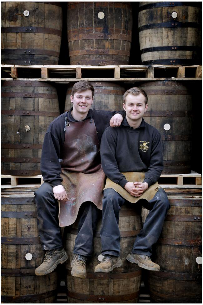 ROLL OUT THE BARREL: Apprentices Stewart Millarvie and Fraser Henderson, at William Grant in Girvan, celebrate passing their cooperage test.