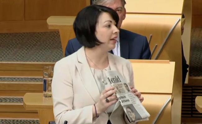 Monica Lennon, the Labour MSP, highlights previous coverage in The Herald while quizzing public health minister Aileen Campbell