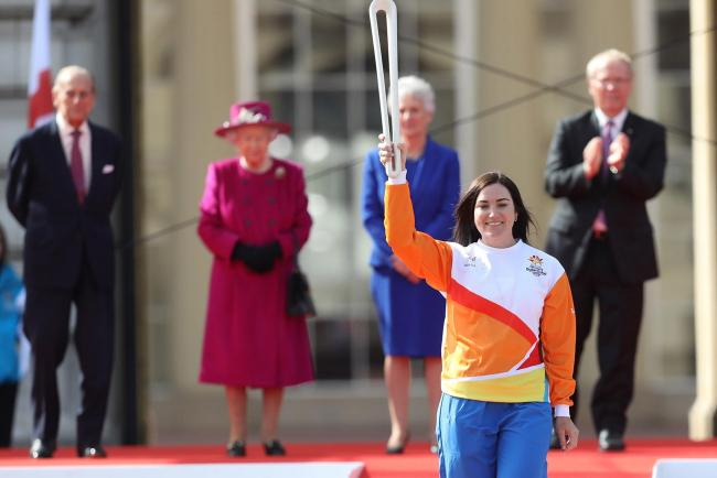 Anna Meares carries the baton at the launch of The Queen's Baton Relay for the XXI Commonwealth Games at Buckingham Palace. Picture: Getty