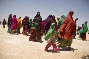 A woman and her child  who haver been forced to move because of drought walk towards a mobile medical unit being run in their settlement  near the town of  Ainabo, Somalia Thursday, March 9, 2017. Lack of rain and other environmental factors mean that a s