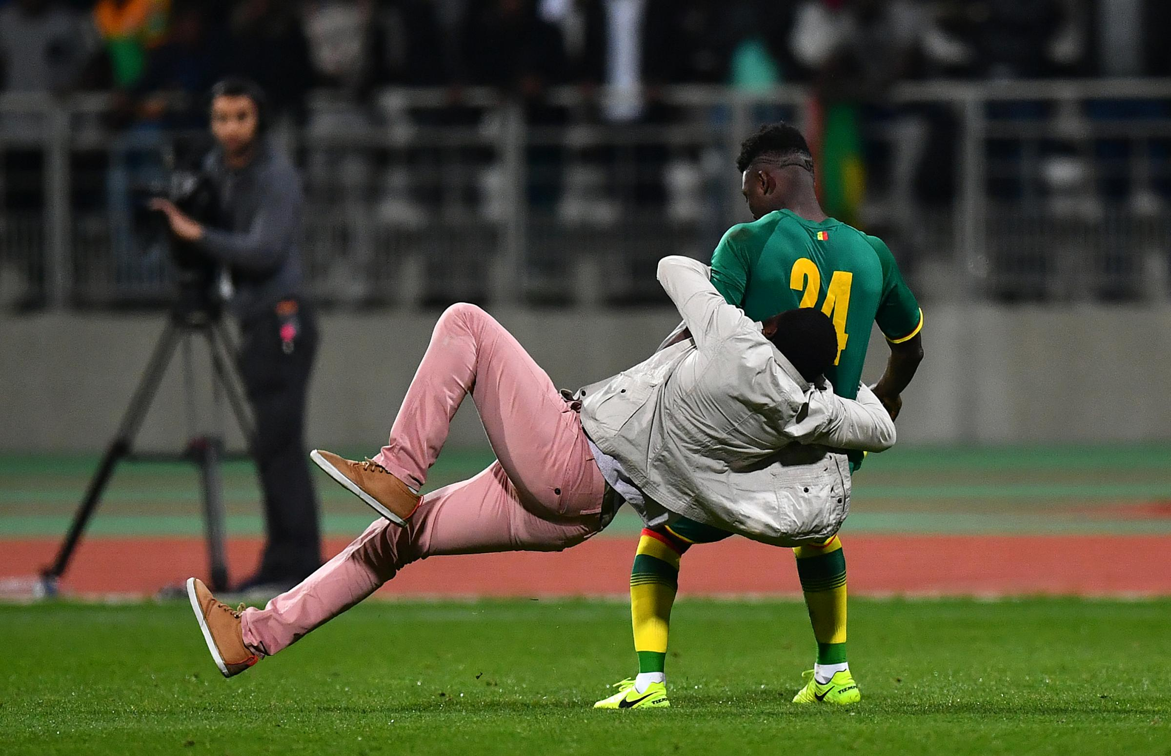 Celtic's Eboue Kouassi caught up in ugly scenes as pitch invasion forces abandonment of Ivory Coast v Senegal
