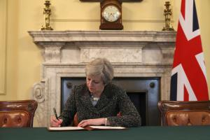 'Pivotal moment' for UK as PM May signs EU divorce papers