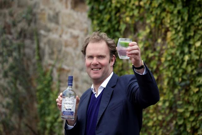 Darnley's Gin / Wemyss Company; photographs at Kings Barns Distillery Fife of owner William Wemyss, pictured outside the old cottage, site of the new Gin Distillery.