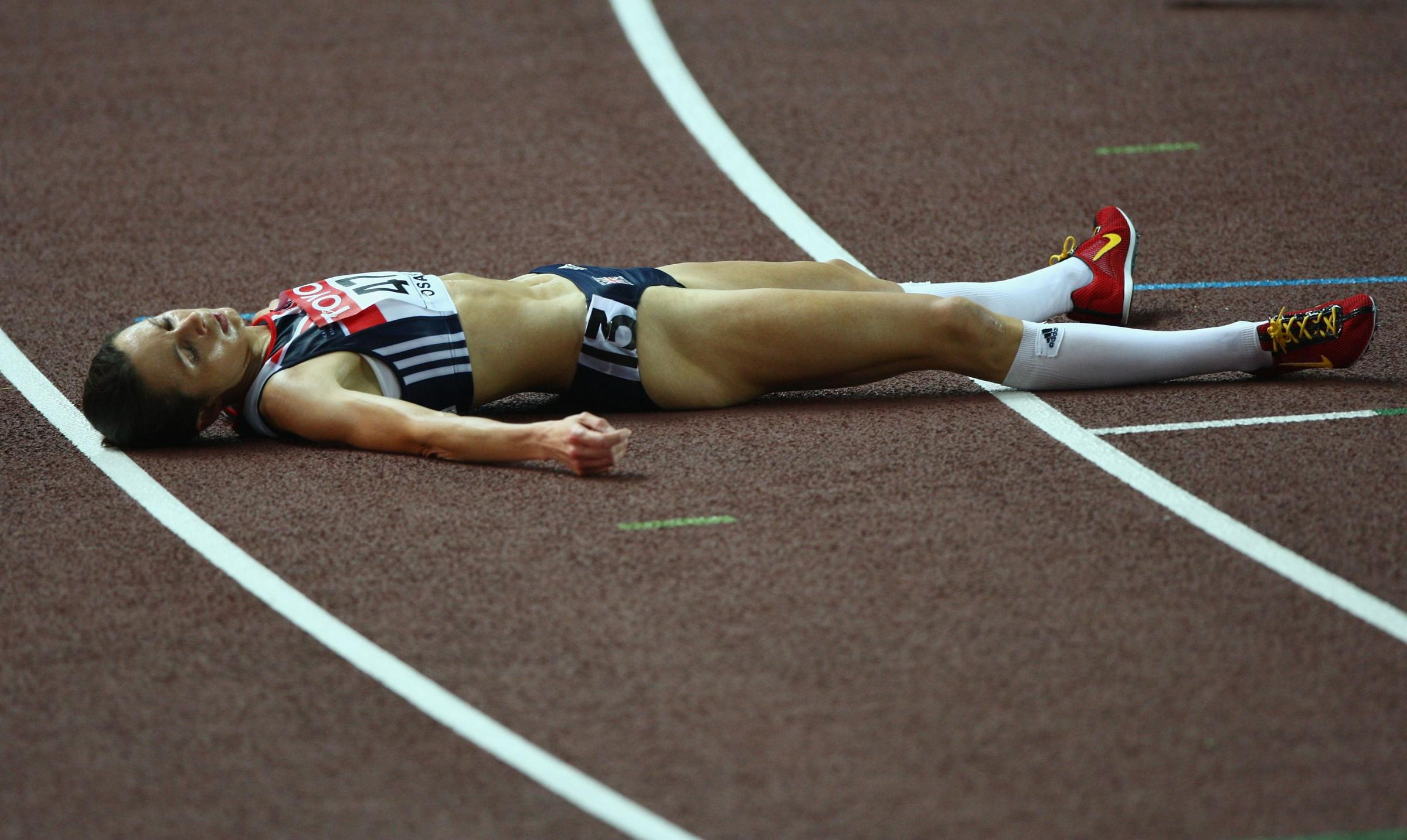FLASHBACK: Jo Pavey of Great Britain lays exhausted after finishing fourth in the women's 10,000m final at the 2007 World Athletics Championships in Osaka. Picture: Getty Images