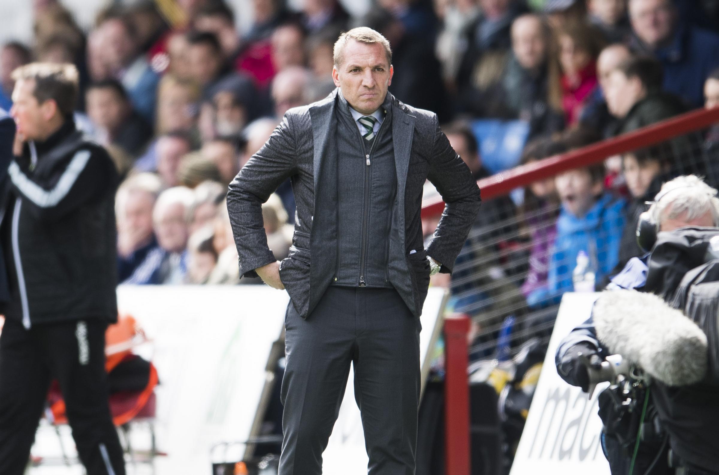 Celtic boss Brendan Rodgers tells referee Don Robertson he owes Erik Sviatchenko an apology