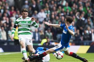 Celtic's Patrick Roberts is challenged by Rangers' Andy Halliday at Hampden on Sunday. Picture: SNS