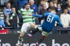 Celtic's Patrick Roberts (left) is fouled by Myles Beerman. Picture: SNS