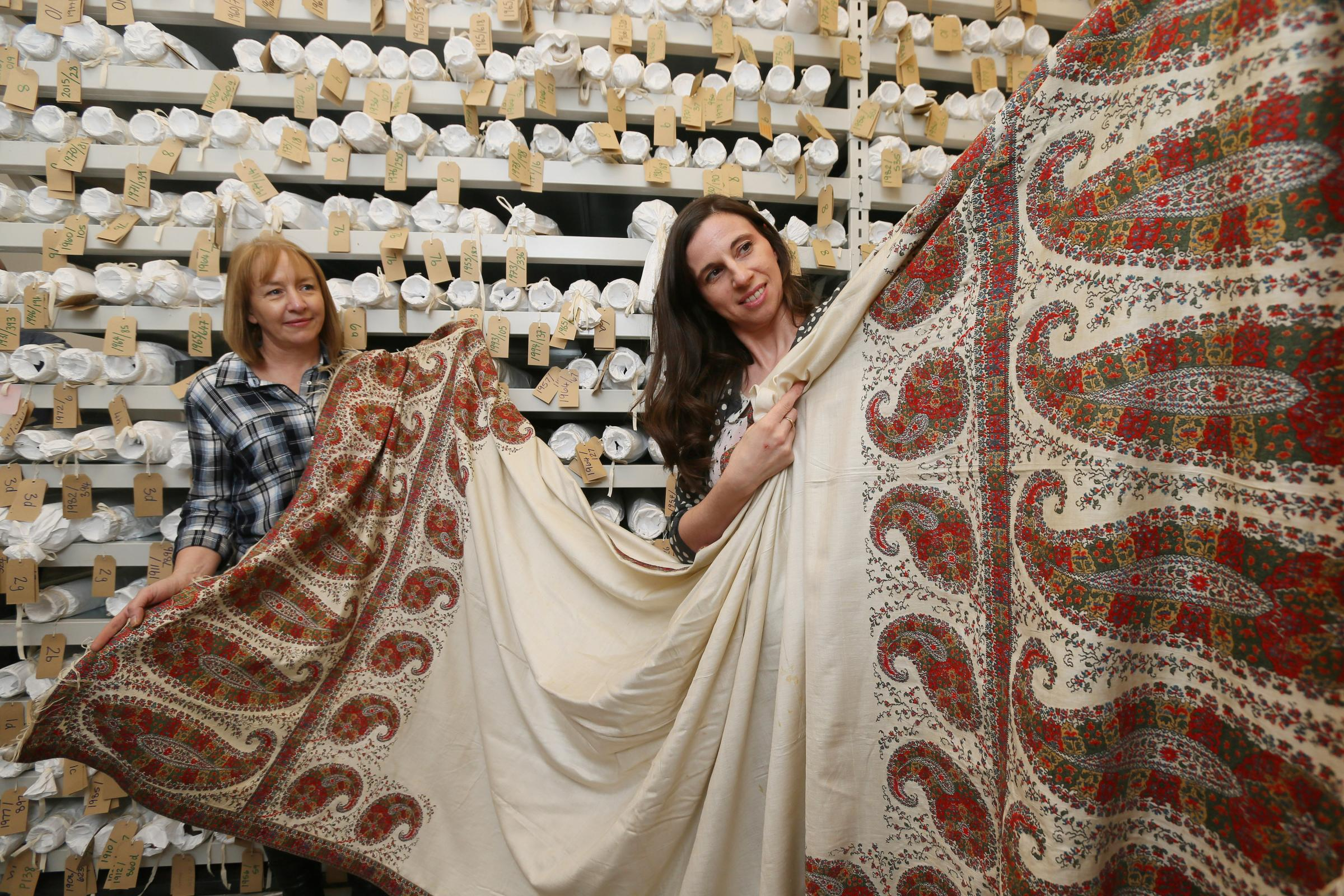 Pam Logue, of Paisley Museum, with a Paisley Pattern shawl dating from about 1820. Picture: Colin Mearns