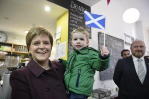Nicola Sturgeon poses with Alasdair Murray, 2, at the Bank Cafe in Neilston