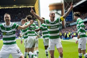 Celtic captain Scott Brown leads the celebrations after a historic day for his club at Ibrox