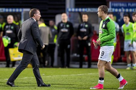 HeraldScotland: Celtic manager Brendan Rodgers, left, walks past Leigh Griffiths at full-time at Firhill.