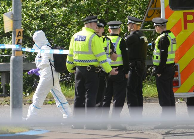 Forensics officers in Glasgow.