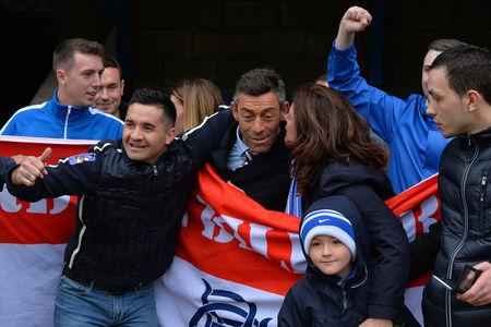 HeraldScotland: Rangers manager Pedro Caixinha is mobbed by Rangers fans after his side's 2-1 victory following the Ladbrokes Scottish Premiership match at McDiarmid Park. Picture: PA