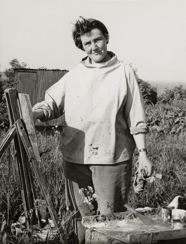 C:\Users\KeithBruce\Pictures\Joan Eardley standing in the garden at her easel, facing the camera, 1961.jpg