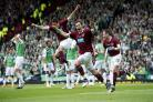 BEST BARR NONE: Hearts defender Darren Barr wheels away in celebration having given his side the lead as the Hibs defenders stand bewildered . . . Pictures: SNS