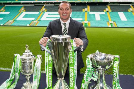 HeraldScotland: Celtic manager Brendan Rodgers with the William Hill Scottish Cup, Ladbrokes Premiership and Betfred Cup in Celtic Park.