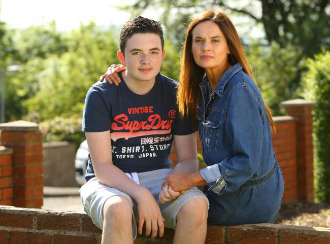 Sandra Blyth pictured with her 13 year old son Sam at home in Dumfries. Sam has MS and is one of the youngest people in Scotland to have the condition (Pic: Colin Mearns - Herald & Times)