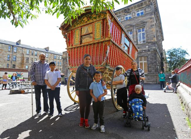 FOR SUNDAY HERALD. NB names to follow..Glasgow Museums Gypsy caravan visit to Annette street primary school, Govanhill. The caravan dates from 1918 and normally resides at Glasgow Museums resource centre, Nitshill. Pictured from left- Akhtar Ahmed with hi