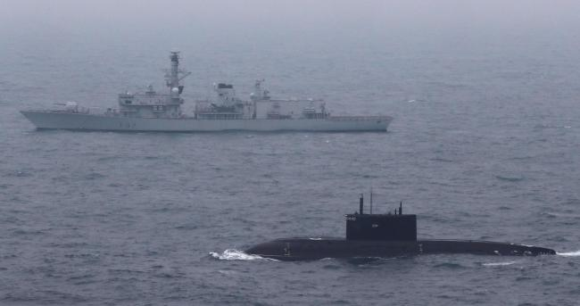 Royal Navy Type 23 Frigate HMS Somerset escorting a Russian submarine through the English Channel. PA