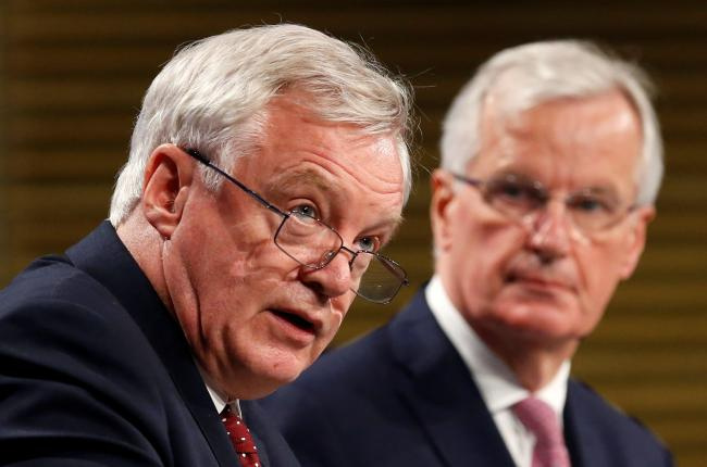 Tory Brexit Secretary David Davis, left, and the EU's chief negotiator, Michel Barnier, who called on the British to come back with clearer aims.