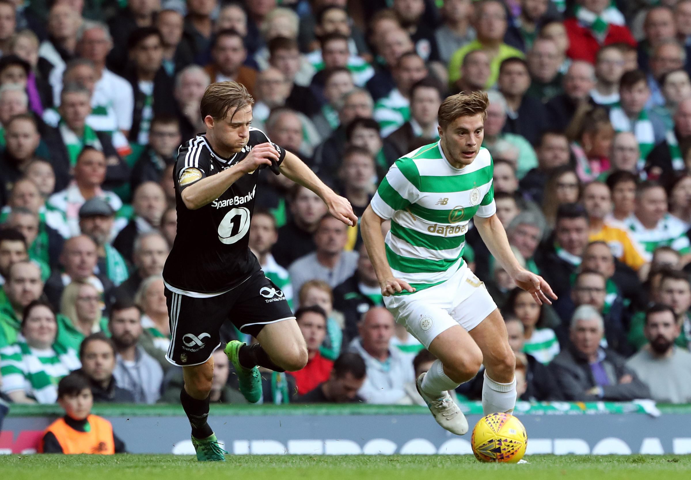 Celtic's James Forrest and Rosenborg's Yann-Erik de Lanlay battle for the ball during the UEFA Champions League third round qualifying round, first leg match at Celtic Park, Glasgow..
