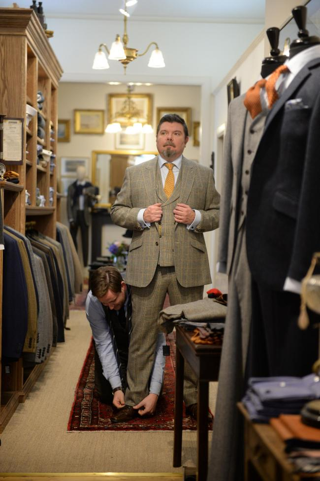 Walker Slater Feature.Sunday Herald Editor Neil MacKay and Deputy Editor Thomas Hawkins go shopping for bespoke suits in the newly opened Walker Slater Shop on Glasgow's Brunswick Street..Shop manager Kean Martin assisted Neil and Assistant manager Mi