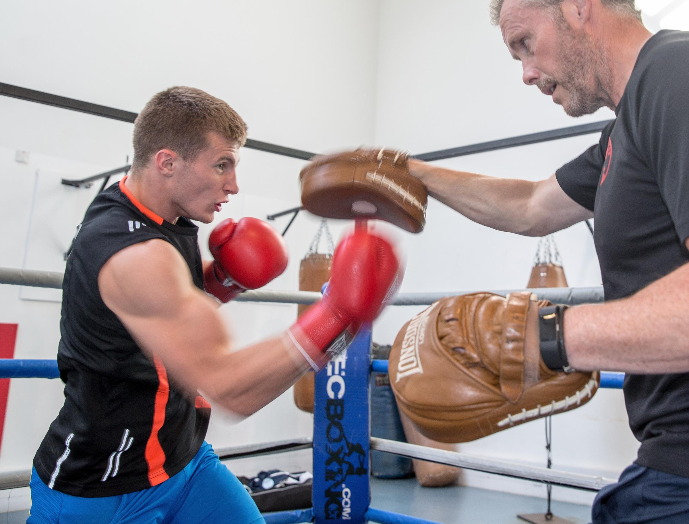 Sean Lazzerini prepares to bare his teeth ahead of Boxing World Championships