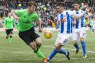 Celtic's Anthony Ralston (left) and Kilmarnock's Greg Taylor battle for the ball during the Scottish Premiership match at Rugby Park