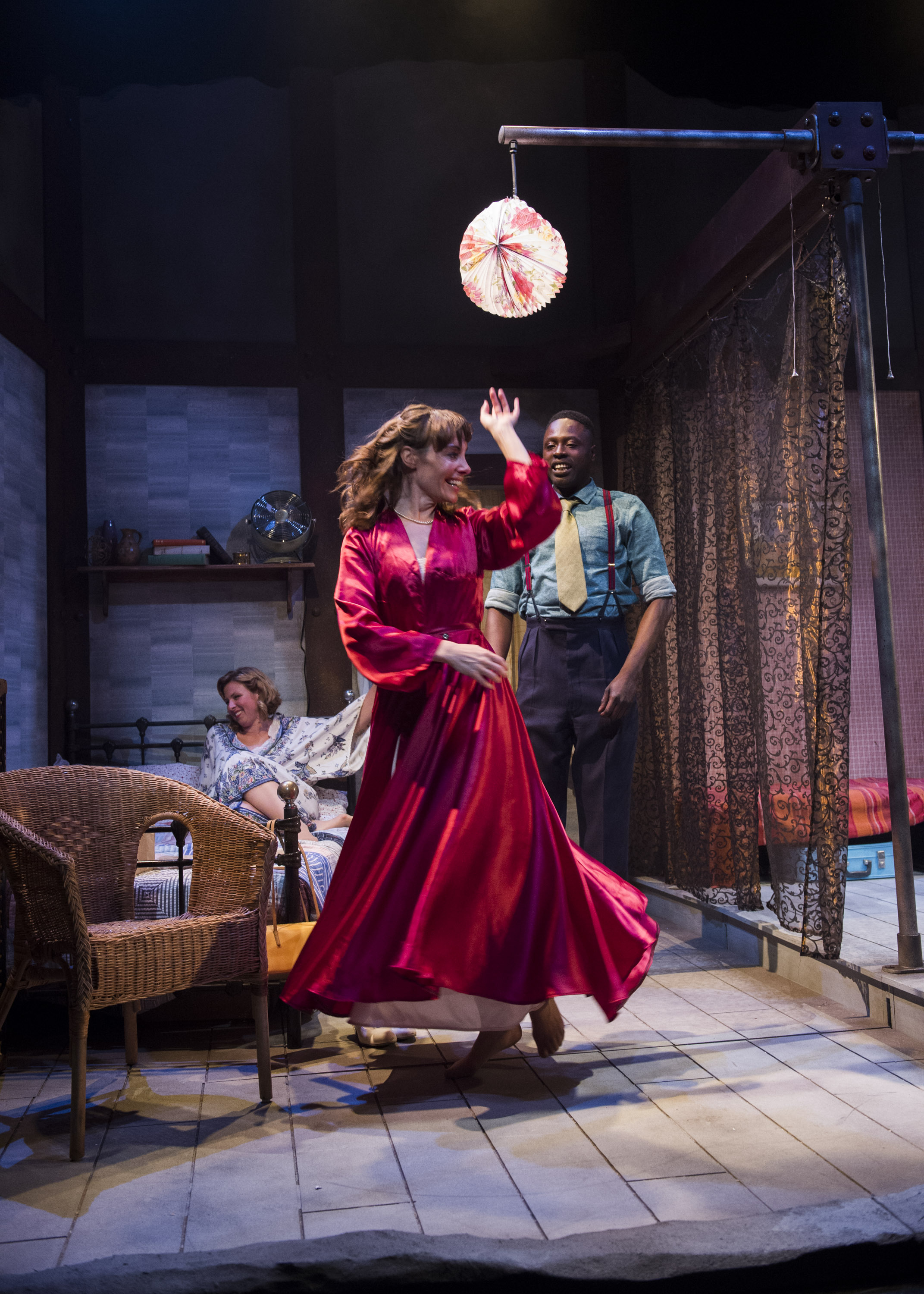 Gina Isaac (front) as Blanche with Julia Taudevin as Stella and Kazeem Tosin Amore as Mitch in Rapture Theatre's A Streetcar Named Desire. Picture: Richard Campbell.