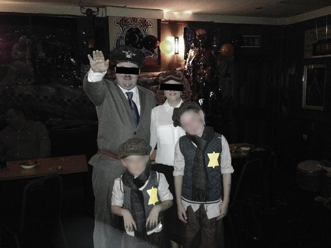 People dressed as Nazis at a party organised by a loyalist flute band and held at an Orange Order hall