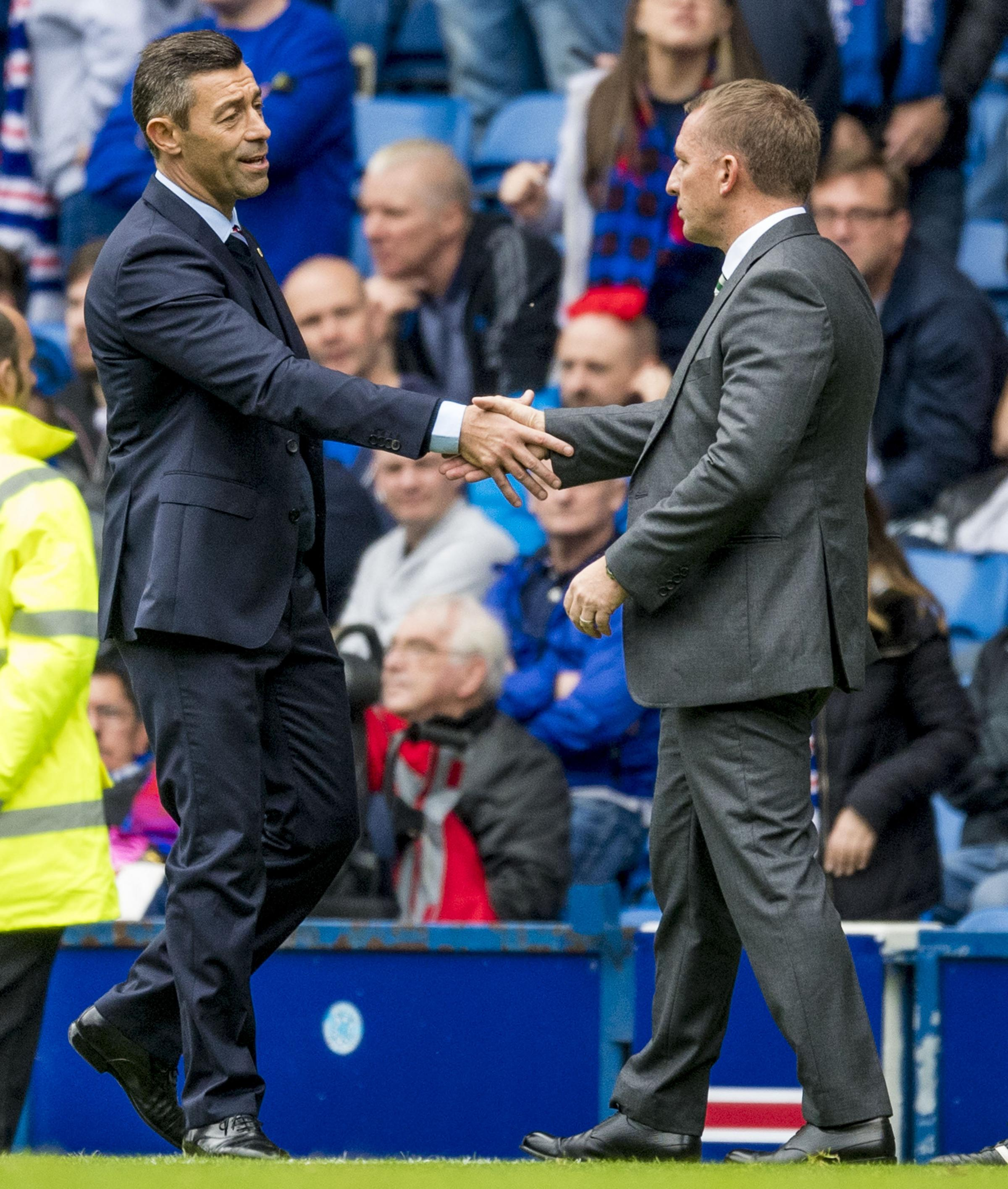 Brendan Rodgers and Pedro Caixinha shake hands at Ibrox but the Celtic manager was not impressed his the counterpart's behaviour