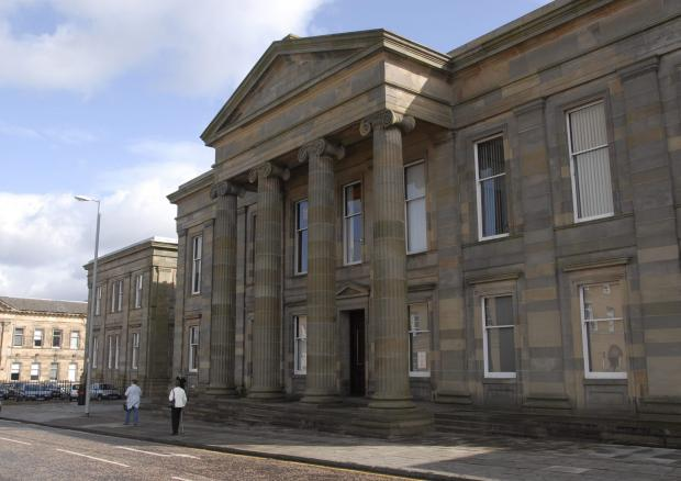 HeraldScotland: Hamilton Sheriff Court, where Mr Mackay represented himself in a dispute over guardianship fees