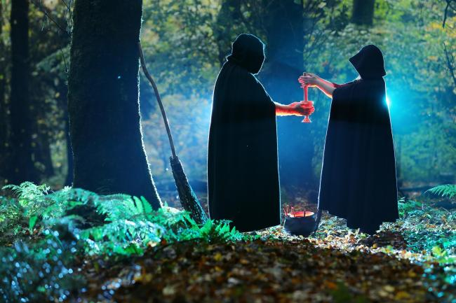 Two witches performing a full moon ritual in a wood in Scotland