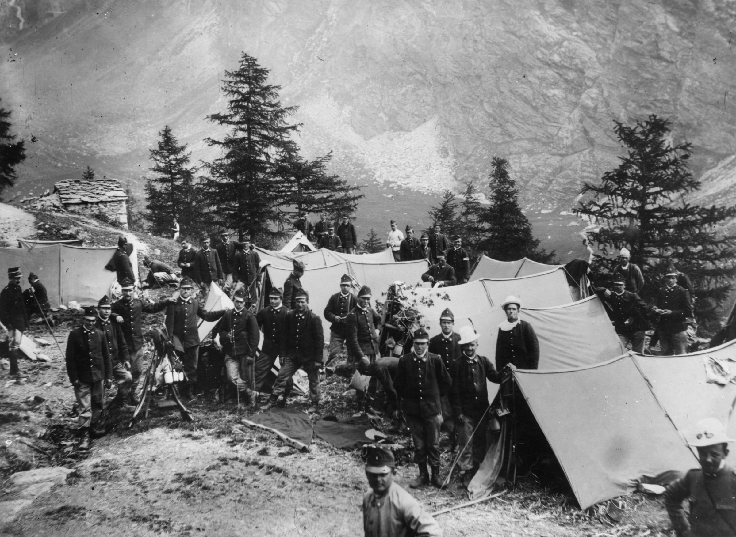circa 1914: A group of Alpine Infantry soldiers camped at the foot of Mount Vilau in the Italian Alps during World War I. (Photo by Hulton Archive/Getty Images)