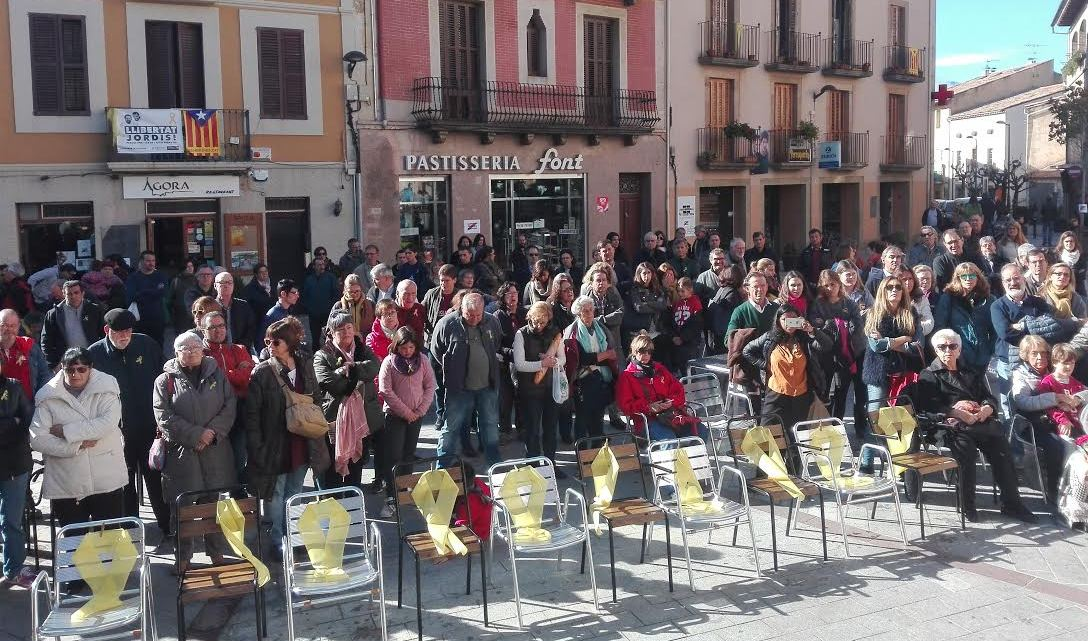 Empty chairs in the village Viladrau, each representing a politician arrested by Spain and held without trial