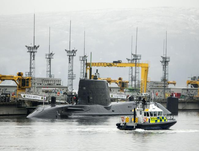 File photo dated 20/01/16 of Astute-class submarine HMS Artful, at HM Naval Base Clyde, also known as Faslane, as Theresa May will tell MPs not to gamble with the safety of British families ahead of a Commons vote on whether to renew the Trident nuclear d